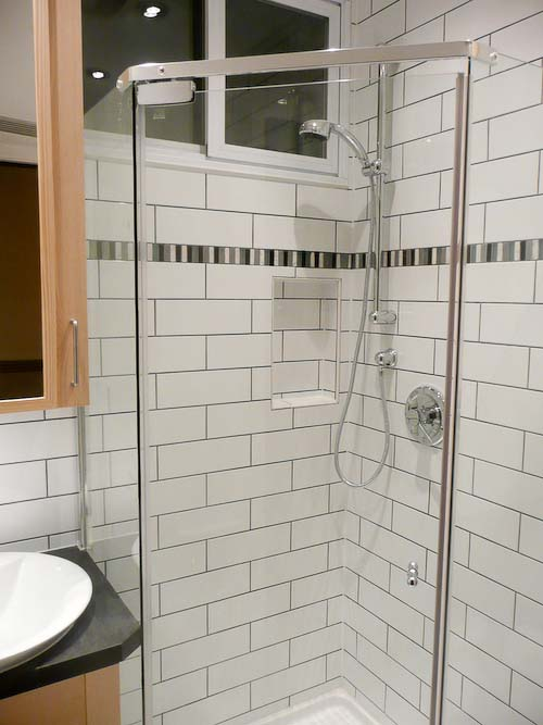 to make room for more storage, we replaced the tub with a glass shower