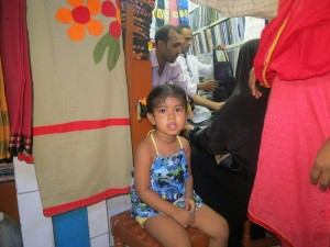 Isha waiting at a sari shop in New Market. (Blue Salamander top and pants by Alison.)